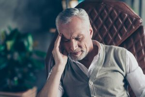 Man leaning into hand while stressed